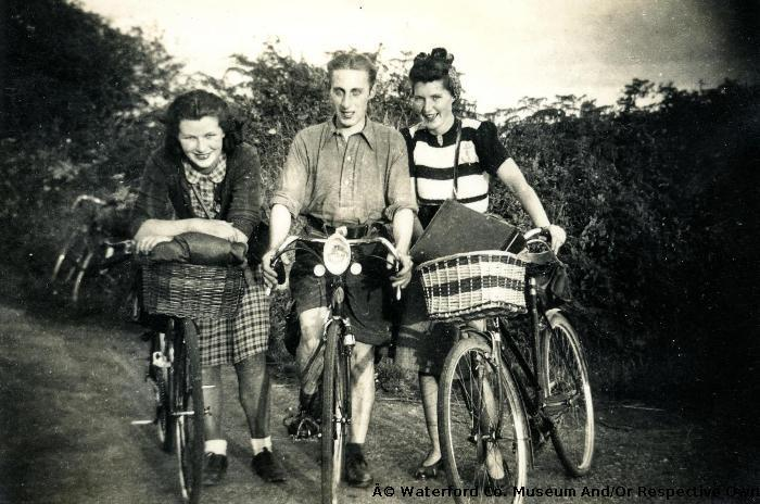 Three People With Bicycles