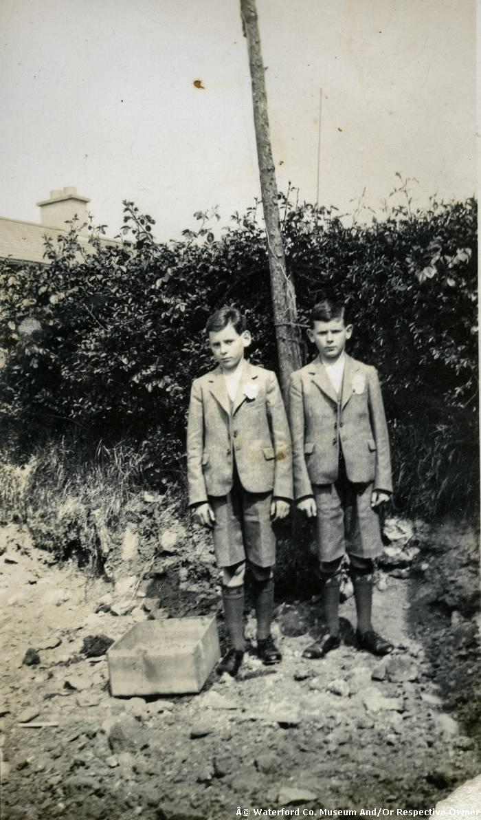 Two Young Men Posing For A Photograph