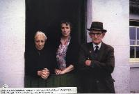 Three People At Doorway Of House In Ballynagoul, ( Baile Na nGall) Ring