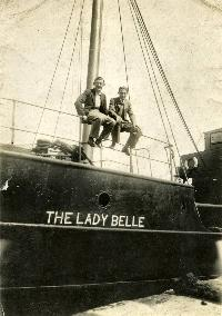 Two Men Sitting On The Bow Of The Lady Belle