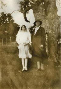 Lady With Girl In Confirmation Dress And Veil.