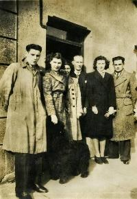 A Small Group Of People Posing For A Photograph