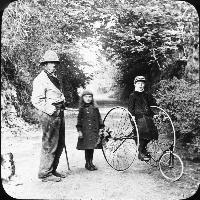 Brenan Children, Tricycle And Country Working Man.