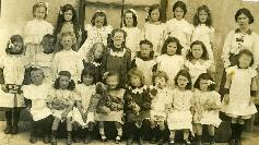 A Large Group Of Children Posing For A photograph