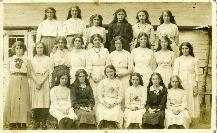 A Large Group Of Young Ladies Posing For A Photograph